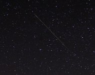 A meteor streaks over the North Star in the northern skies during the Perseid me