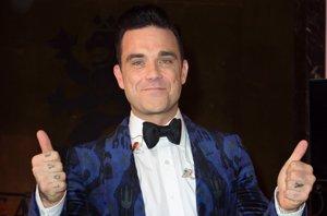 Foto: Robbie williams 'pisa los talones' a George Clooney como agente secreto (CORDON PRESS)